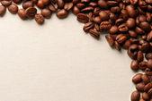 Coffee grains on a rough sacking — Stock Photo