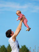 A young father with his young baby. — Stock Photo