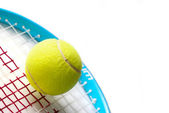 A tennis ball and racket — Stock Photo