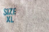 Real macro of XL size clothing label — Stock Photo
