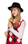 Girl with flower in black hat — Stock Photo