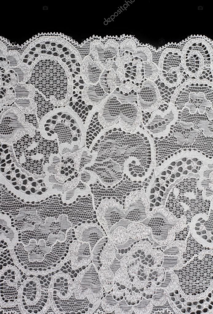 Decorative white lace with pattern on black background  Stock Photo #2013101