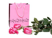 Rose gift package and three roses — Stock Photo