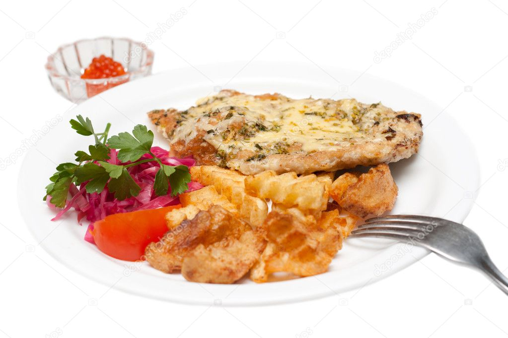 Fried meat in melted cheese and potatoes with salad and roe on plate  Stock Photo #2082480