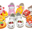 Stock Photo: Baby sandals exposed by semicircle