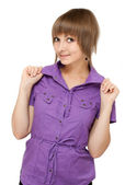 Young girl in violet blouse looks — Stock Photo