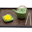 Bamboo tray, green ceramic teapot — Stock Photo