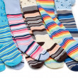 Stock Photo: Colour baby striped pantyhose