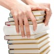 Feminine hands keeps pile of the books — Stock Photo