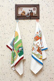 Dishtowels hung on wooden hatrack — Stock Photo