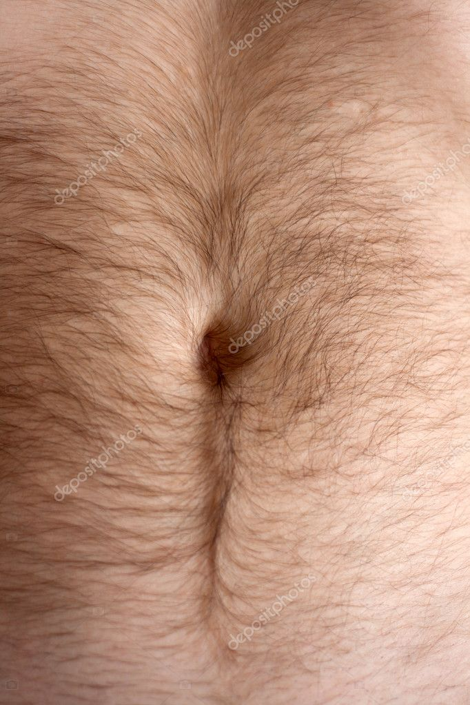 Male hairs belly, bellybutton in light from window — Stock Photo #2501811