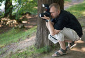 Man with photocamera — Stock Photo
