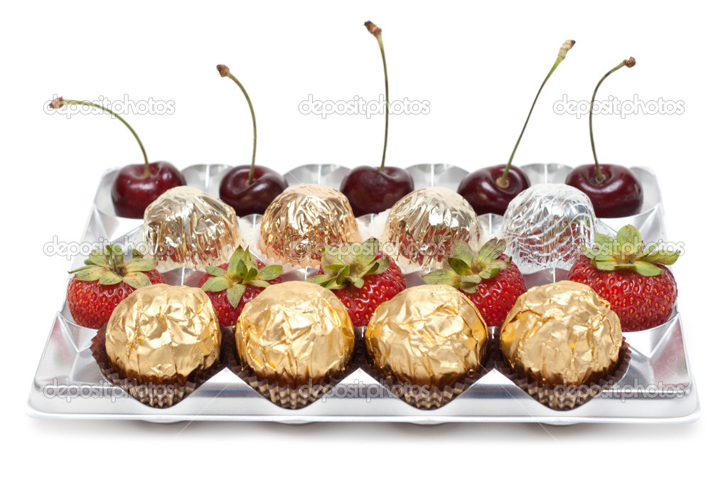 Sweetmeats strawberries sweet cherries in silvery plastic form  Stock Photo #2544484