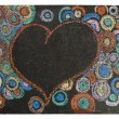 Heart and circles on black chalkboard — Stock Photo