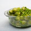 Bowl of freshly steamed peas and vegetab — Stock Photo