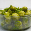 Bowl of freshly steamed peas, vegetables — Stock Photo