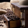 Coffe beans and coffee grinder - Stock Photo