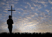 Young man with cross — Stock Photo