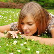 Stock Photo: Young womrests on grass