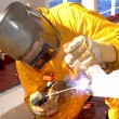 Welder works on deck of chemical tanke - Stock Photo