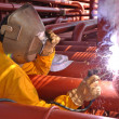 Welder works on deck of chemical tanke — Foto Stock