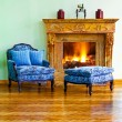 Royalty-Free Stock Photo: Blue armchair fireplace