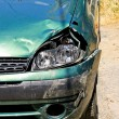 Foto Stock: Green car wreck