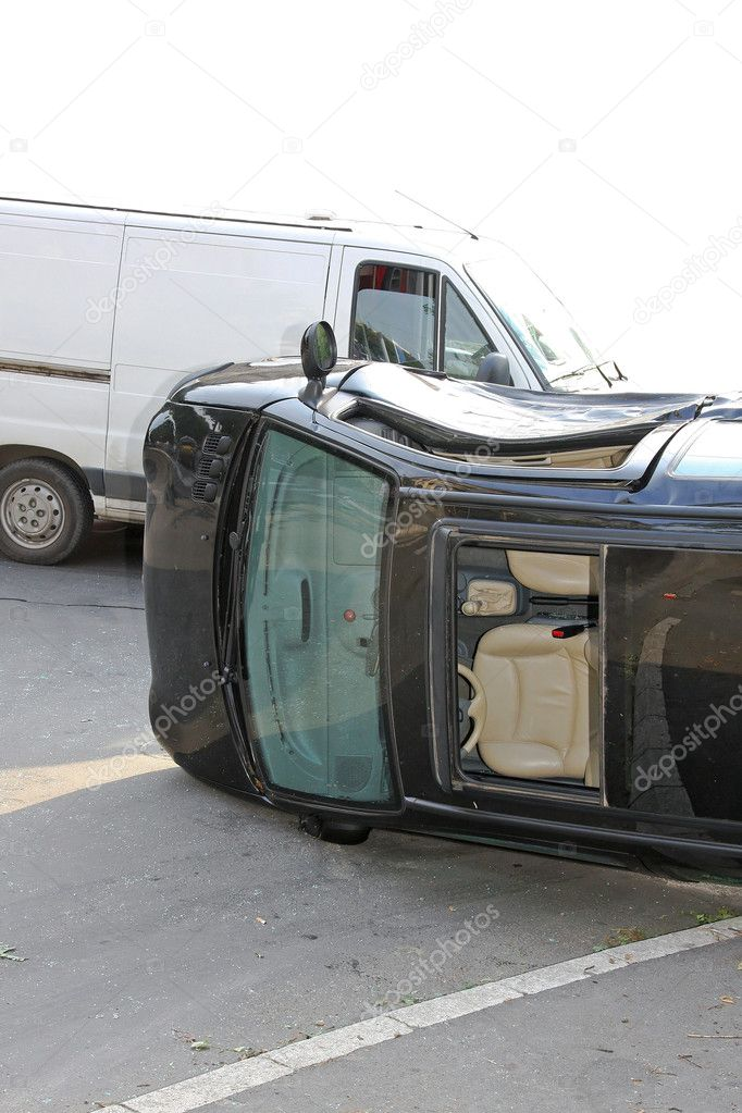 Traffic accident black car roll over side — Stock Photo #2176655
