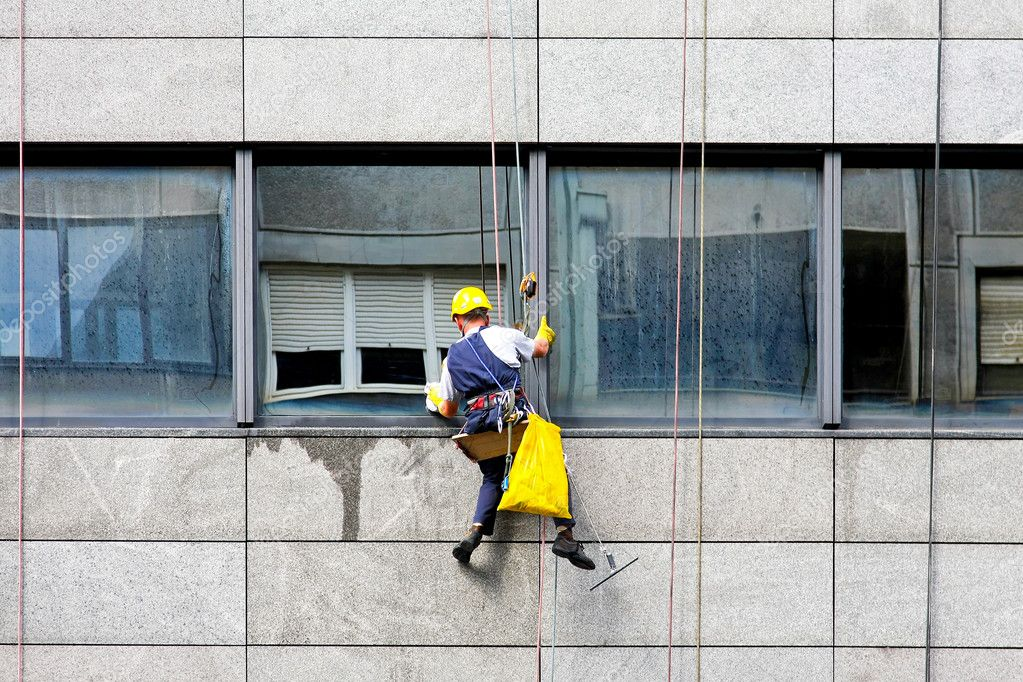 Windows cleaner at danger and risky work  Stock Photo #2205954