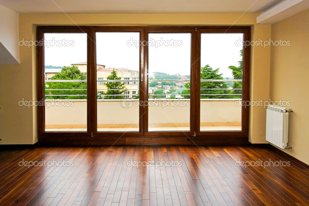 Four glass doors in empty living room — Stock Photo #2207579