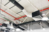 Industrial air duct ventilation equipment at ceiling — Stock Photo