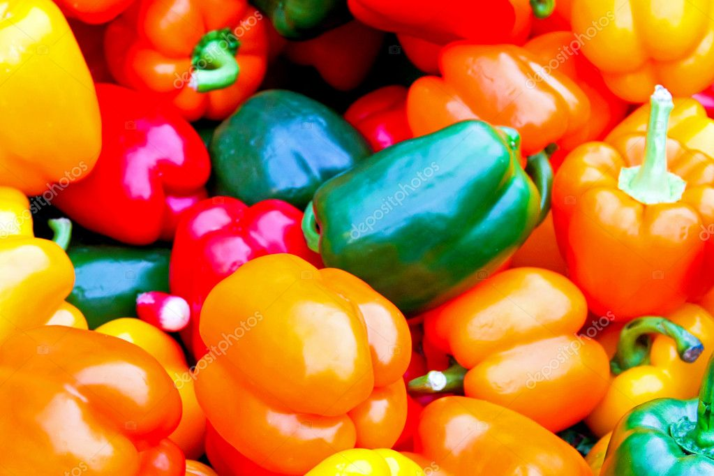 Big bunch of vivid color paprika at market — Stock Photo #2271134
