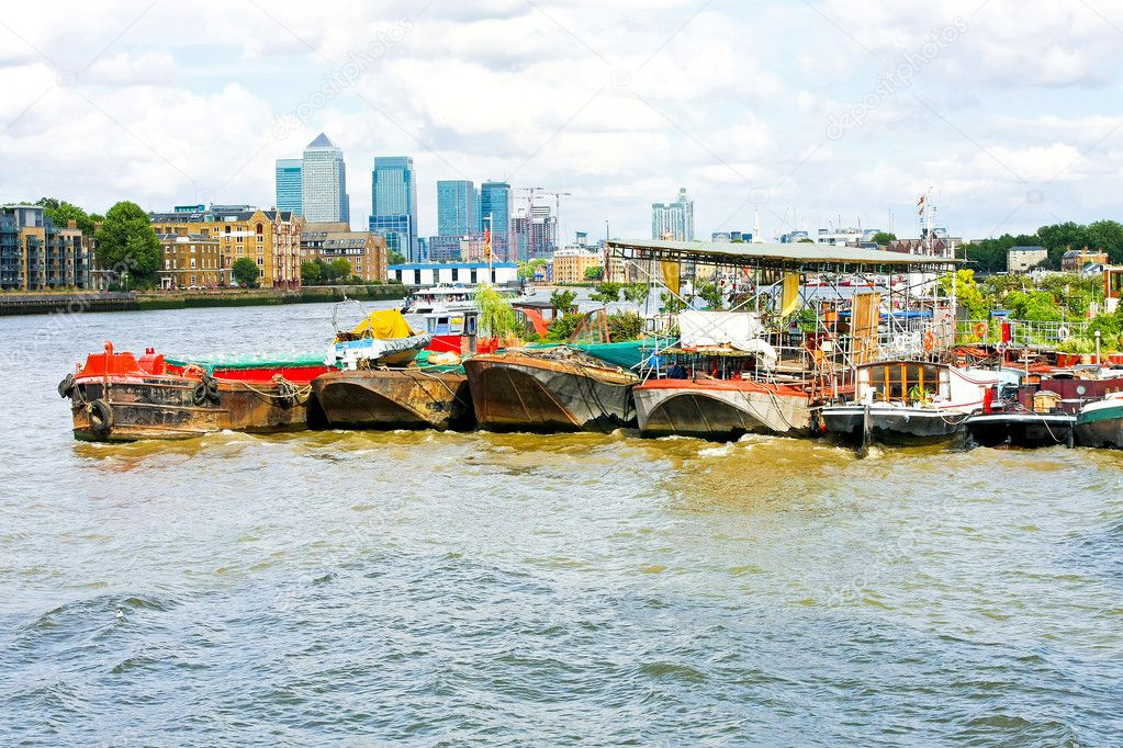 Rusty pontoons at river Thames in front of Canary Wharf  Stock Photo #2523287