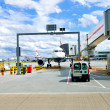 Airplane docking - Stock Photo