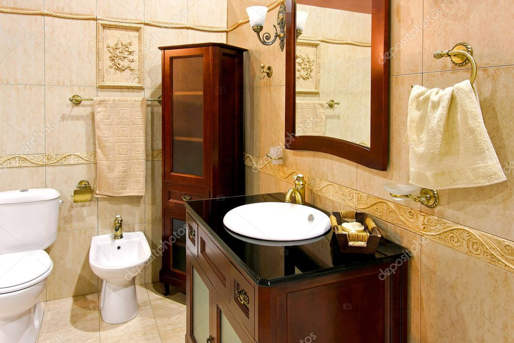Classic style bathroom with brown wood cabinet — Stock Photo #2535859