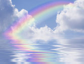 Rainbow and Clouds Reflec — Stock Photo
