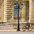 Stock Photo: Street lamp and bicycle