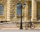 Street lamp and bicycle — Stock Photo