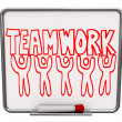 Teamwork on Dry Erase Board with Team Members - Stock Photo