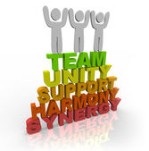 Teamwork - Team Members Stand on Words — Stock Photo