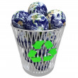 Many Earths in Recycling Basket - Stock Photo