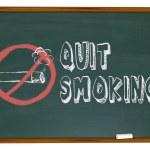 Quit Smoking - Cigarette on Chalkboard — Stock Photo