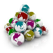 Pyramid of Colorful Planet Earths — Stock Photo