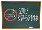 Quit Smoking - Cigarette on Chalkboard — Stok fotoğraf
