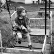 Stock Photo: Little girl on swing