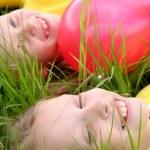 Children and balloons — Stock Photo