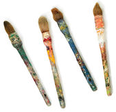 Four dirty brushes. — Stock Photo