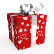 Stock Photo: Red gift box with hearts & tag