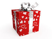 Red gift box with hearts & tag — Stock Photo