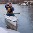 Winter canoe - break for hot tea - Stock Photo